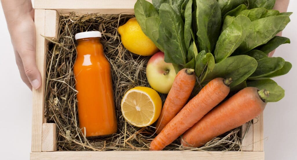 Assorted fruits and vegetables in wooden box for preparing detox smoothie